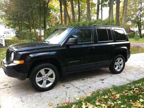 2012 Jeep Patriot 4x4 Moonroof Lower Miles Newer tires for sale in Charlevoix, MI