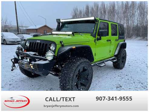 2013 Jeep Wrangler Unlimited Sport SUV 4D 4WD - cars & trucks - by... for sale in Anchorage, AK