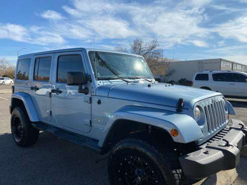 2012 Jeep Wrangler Unlimited Sahara Sport Utility 4D - cars & trucks... for sale in Edmond, OK